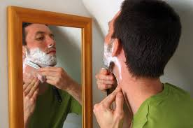A man shaving unwanted hair